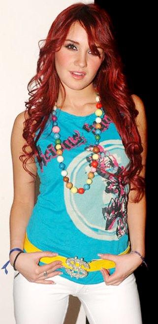 Foto de Dulce María con cabello ondulado