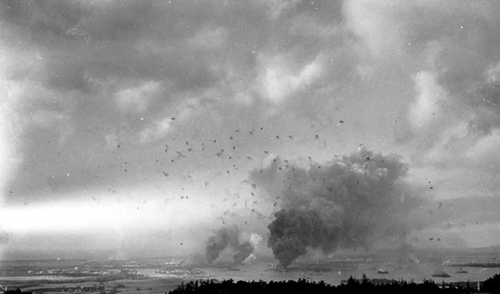 A wide-angle view of the sky above Pearl Harbor, Hawaii, filled with smoke and anti-aircraft fire on December 7, 1941.