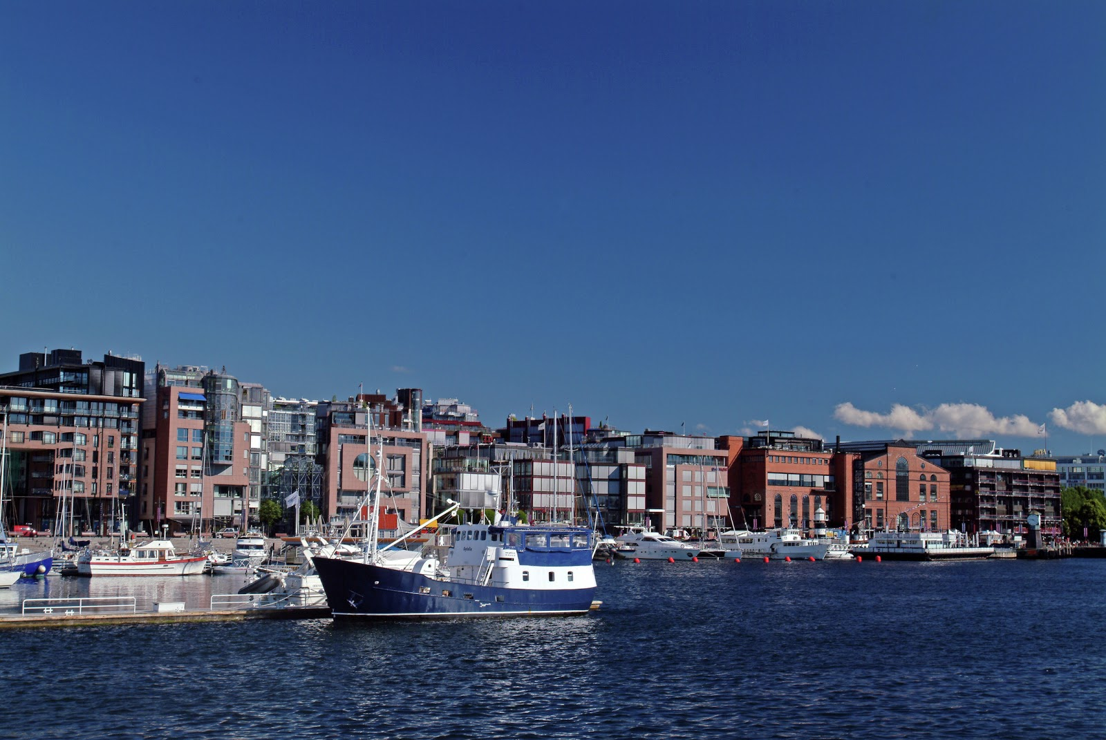 The vibrant shopping district of Aker Brygge as seen from Oslofjord. Photo © Nancy Bundt and VisitNorway.com. Unauthorized use is prohibited.