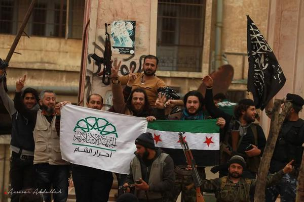 Left to right: flags of Ahrar al-Sham, Free Syrian Army, and Jabhat al-Nusra.