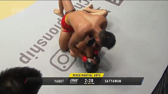 Oscar Yaqut Defs.  Andreas Satyawan  at 2:36 of Round 2!