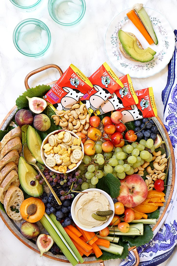 A Big Kid Friendly Snack Platter Filled With Fruit Veggies Hummus Crackers