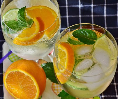 Ice cold water with sprigs of mint and orange slices