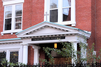 Portico of Greenpoint Reformed Church with Minetta Negro Infirmary Sign