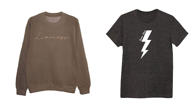 A olive green sweatshirt with lioness written on in gold print and a dark grey tee shirt  with a lightening bolt on