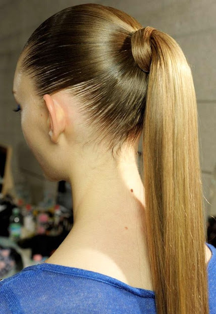 slicked ponytails - haircut