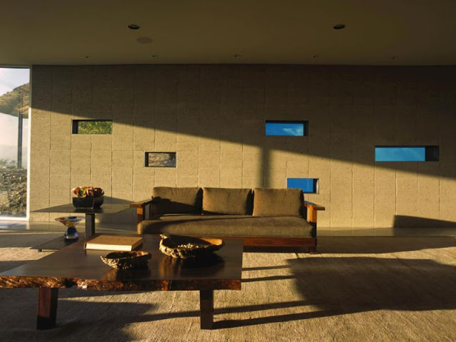 Photo of wooden furniture by the wall with pool windows