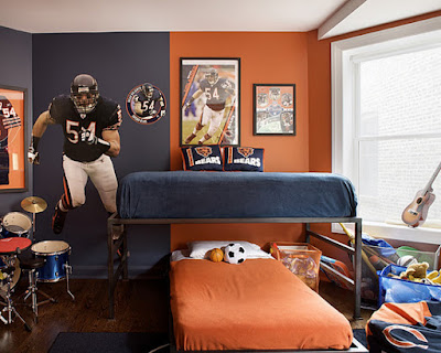 Two-Tones-Design-for-Teenage-Boy-Bedroom-Interior-Color-Idea-Showing-Cool-Orange-And-Navy-Blue-Wall-Paint-Colors-And-Two-Beds-And-American-Football-Wall-Posters-And-Decals