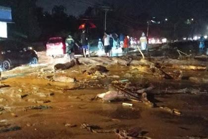 Anggota TNI Selamatkan Bayi Yang Terjebak Banjir Bandang Sentani Selama  6 Jam