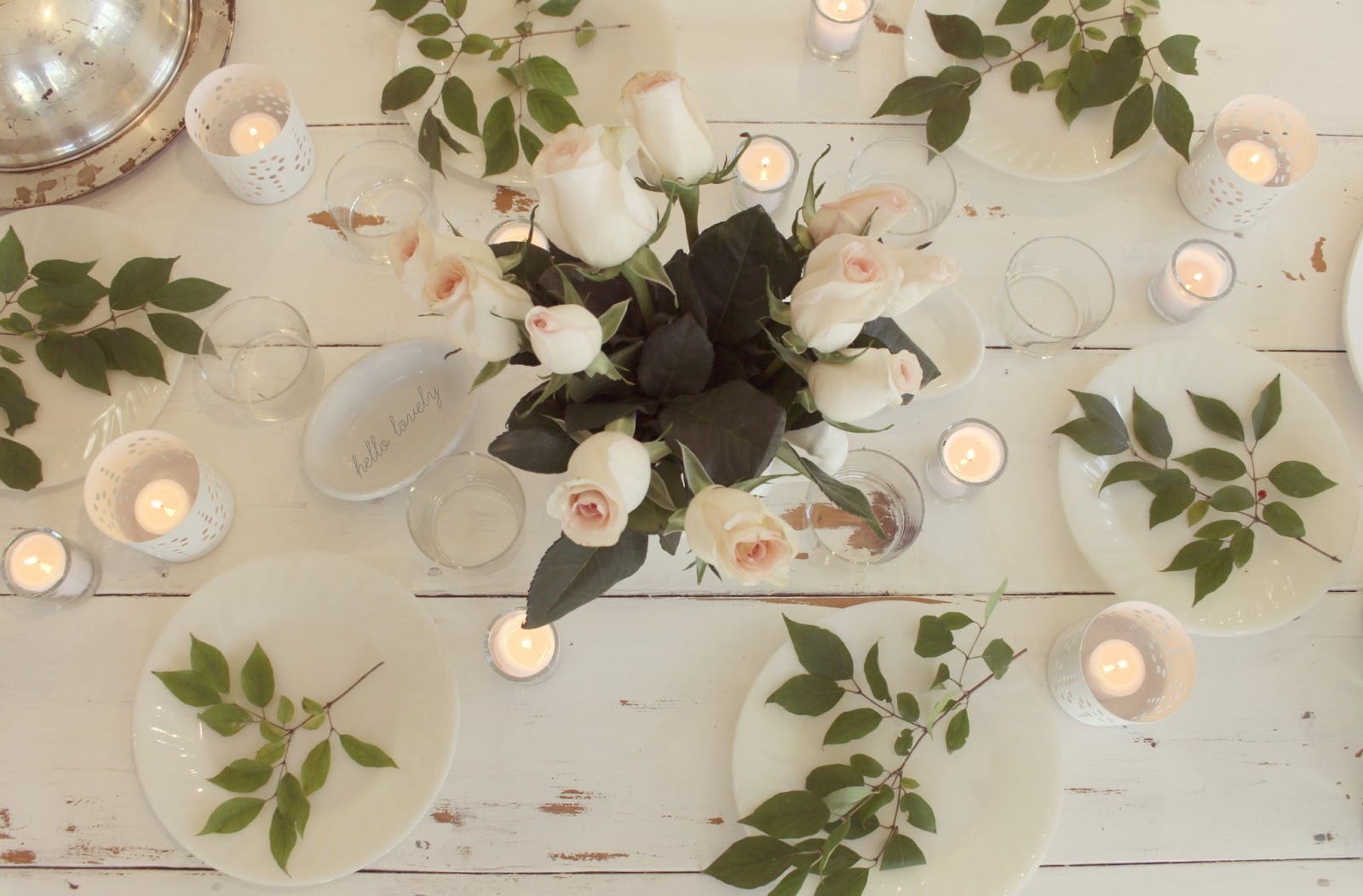 Romantic shabby chic French farmhouse tablescape on white farm table with roses by Hello Lovely Studio