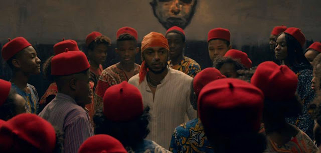 kendrick lamar surrounded by moors wearing red fez