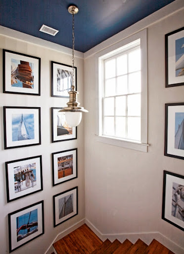 nautical gallery wall stairway