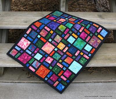 Scattered quilt pattern in batiks