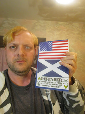 Travis L Salisbury With Defender Book-January 19 2017-A