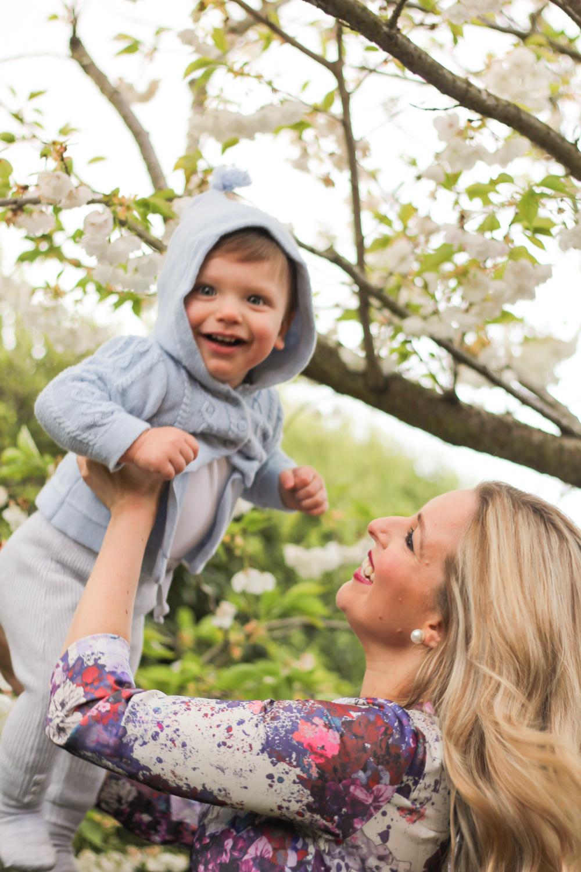 Baby wearing Peter Rabbit blue knit cardigan