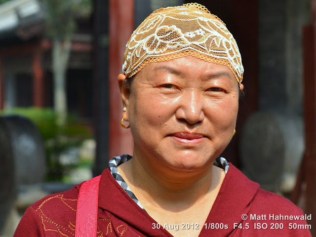 street portrait, headshot, China, Xi'an, Hui Muslims, Hui Muslim woman, lace skullcap