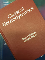 Classical Electrodynamics, 2nd Ed, by John David Jackson, superimposed on Intermediate Physics for Medicine and Biology.