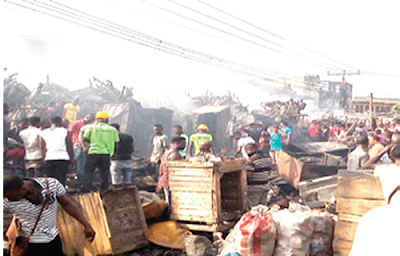 area boys attack ladipo spare parts market