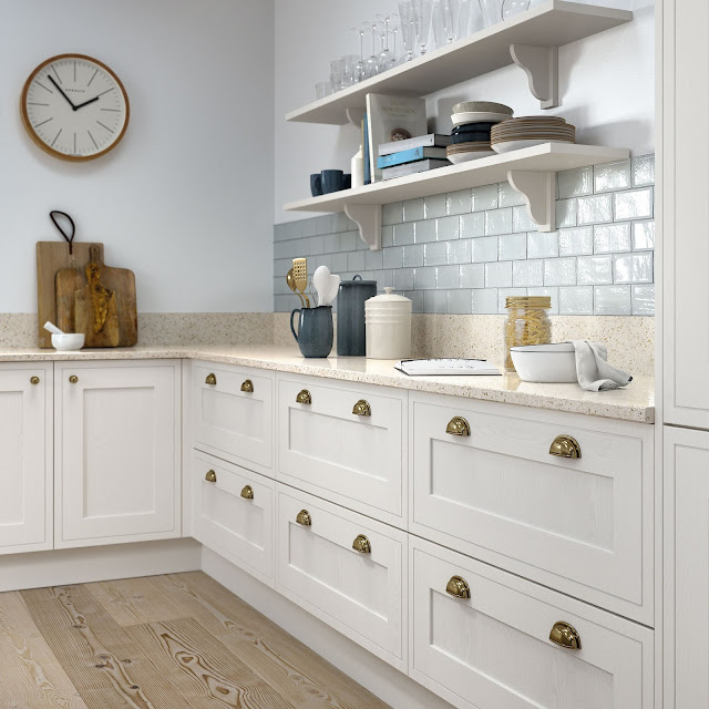 things to think about when designing a small kitchen including storage tips, ways to trick the eye into thinking the room is bigger, lighting and layout options.