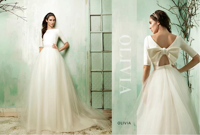 Bonito vestido de novia de estilo retro con falda de tul y espalda abierta en raso con lazo