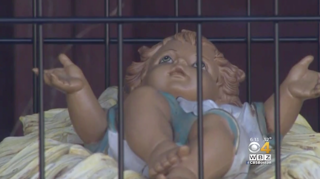 Baby Jesus In Cage As Part Of Dedham Church's Immigration-Themed Nativity Scene