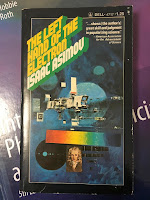 The Left Hand of the Electron, by Isaac Asimov, superimposed on Intermediate Physics for Medicine and Biology.