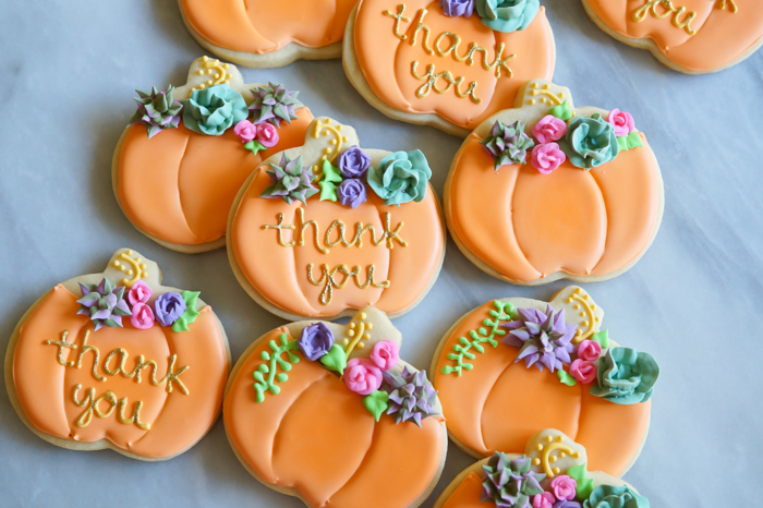 decorated pumpkin cookies with royal icing succulents and roses