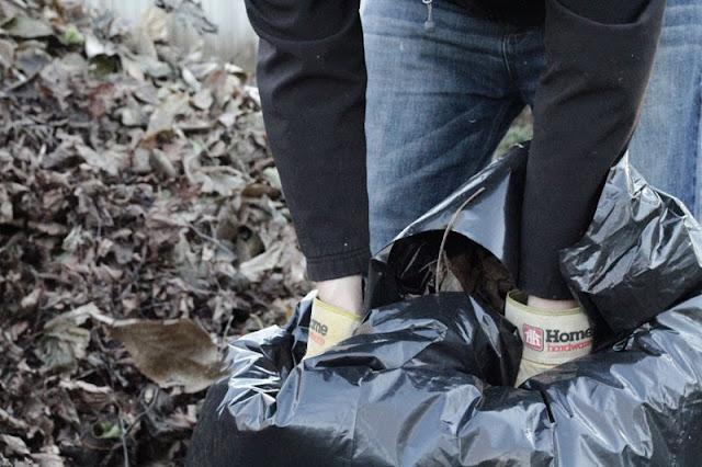 composting leaves in black bags