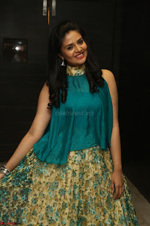 Anchor Srimukhi in green sleeveless top and skirt at O Pilla Nee Valla Movie Audio Launch Feb 2017 122.JPG