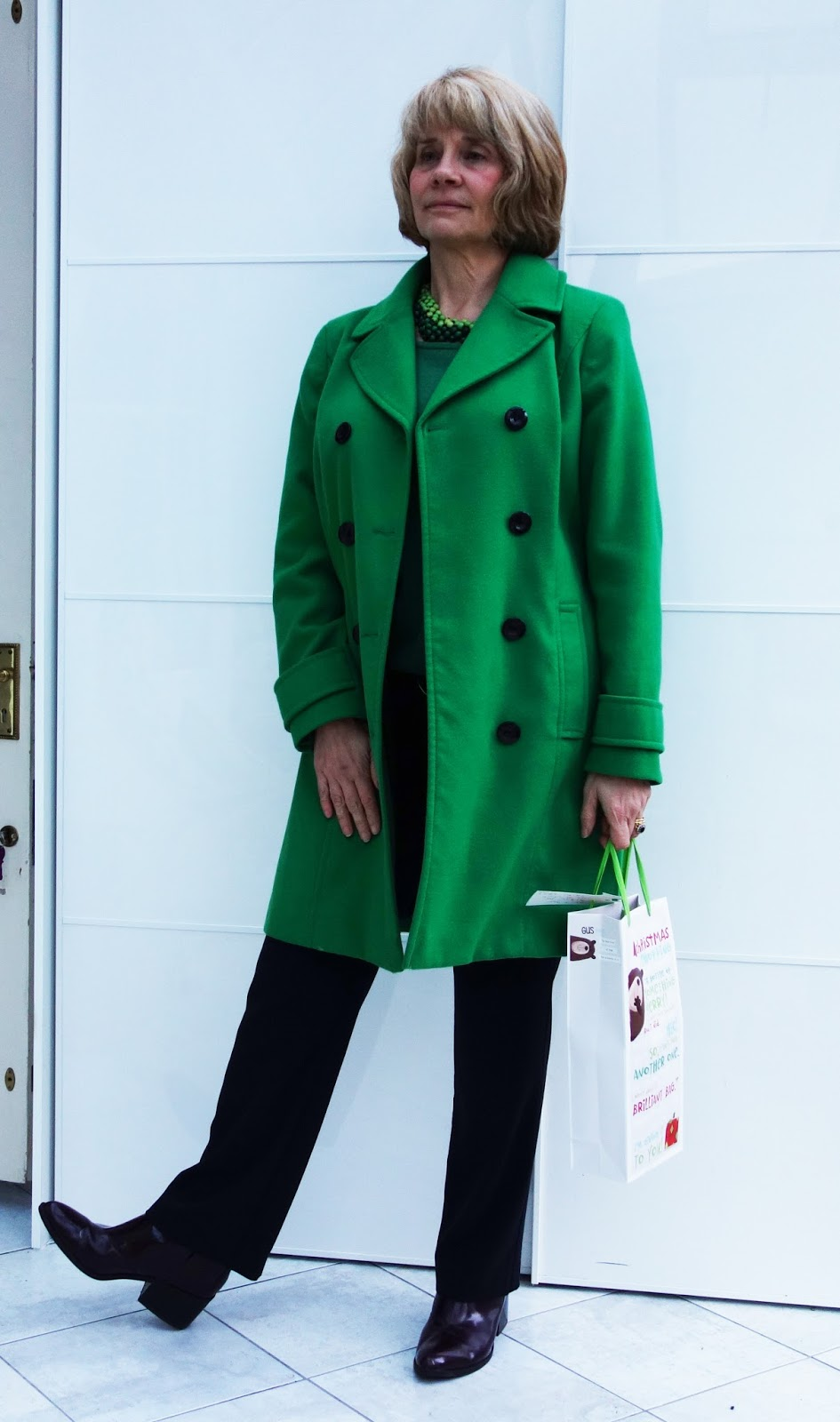 Green coat from Marks and Spencer with navy trousers and burgundy boots