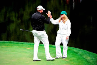 Shane having fun with his wife Wendy at the golf courytard