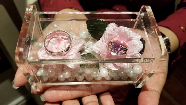 acrylic box with wedding rings faux flowers and pearls