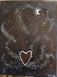 Night sky. Sacred heart wrapped in stars. Stars curl out like flames filling the sky. Moon with 2 stars sit in the background.