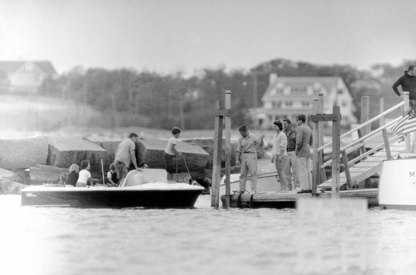 President John Kennedy, right, and his wife, Jacqueline, wearing bathing suit, stand on a pier after spending the afternoon boating on Nantucket Sound at Hyannis Port, Massachusetts, on August 5, 1961. The President and U.N. Ambassador Adlai E. Stevenson conferred aboard his yacht during the cruise.