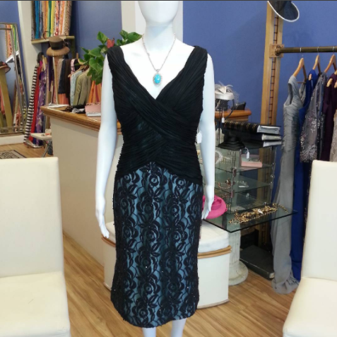 Dress on sale $250. Black chiffon rouged bodice. Lace skirt in black lined with a turquoise lining. For any occasion.