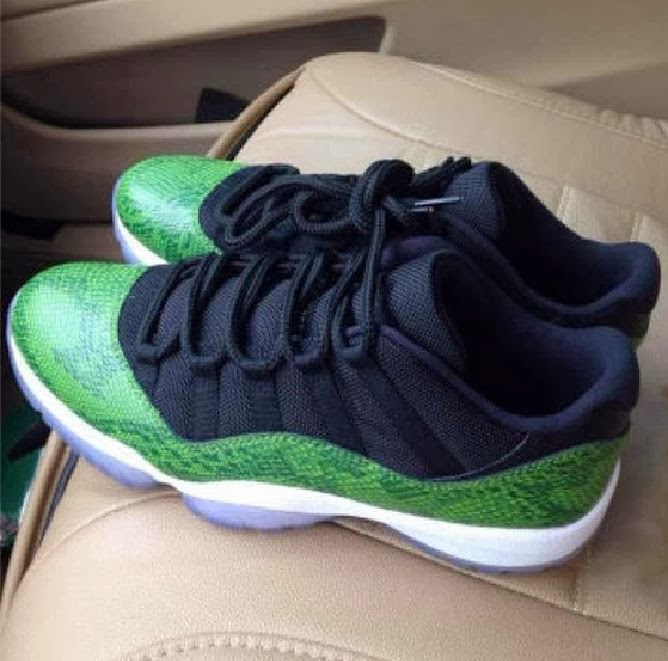 5416306cb141 Here is a new image via SG at the 2014 Air Jordan 11 XI Low Green Snake  Skin Sneaker releasing on April 19th