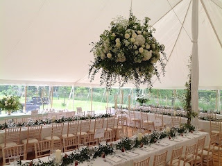 wedding reception floral display, marquee