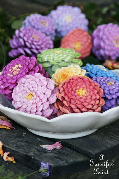 http://afancifultwist.typepad.com/a_fanciful_twist/2015/04/lets-make-zinnia-flowers-from-pine-cones.html