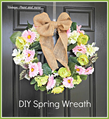 a diy spring wreath made with grapevine wreath and faux flowers, burlap ribbon