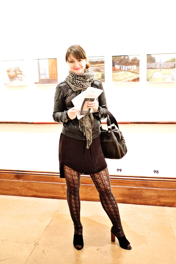Tango style, asymetric skirt, black lace stockings, leather jacket and animal print scarf at Juniper Hall, Marie Mansfield paintings in background. Street Fashion Sydney - Photographed by Kent Johnson.