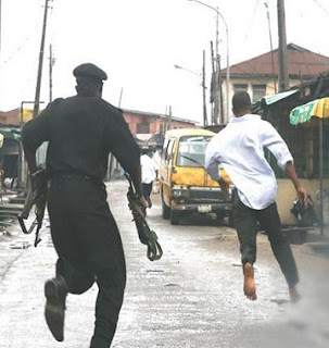 Police Shoots Man For picking Money left By Robbers