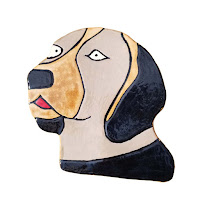 One wall hanging ceramic dog