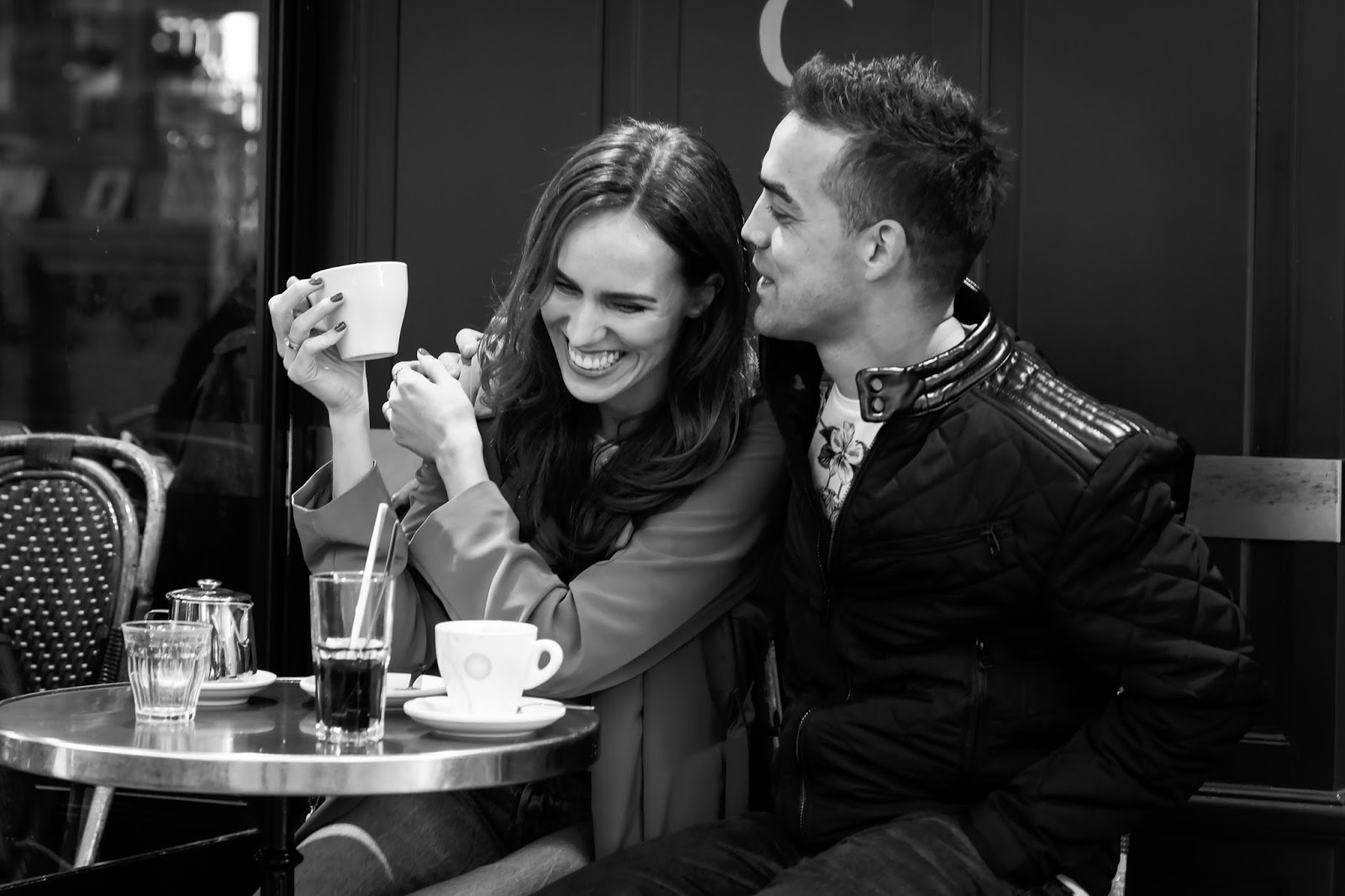 couple laughing photo black white cafe