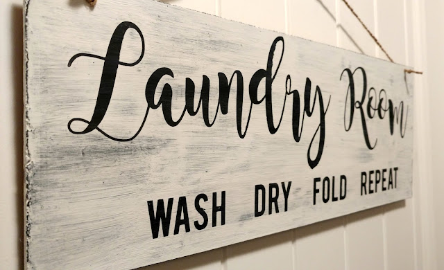Paint and vinyl are all it takes to make this cute DIY laundry room sign