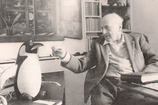 Black and White Photo of Architect Berthold Lubetkin Pretend Feeding a Plastic Penguin