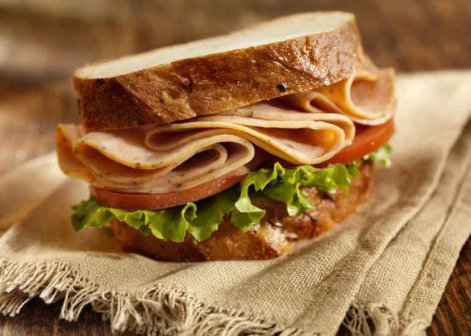 Transform your leftovers with these inventive roast turkey sandwich.