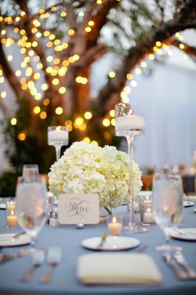 Hydrangea centerpiece and pale blue tablecloth