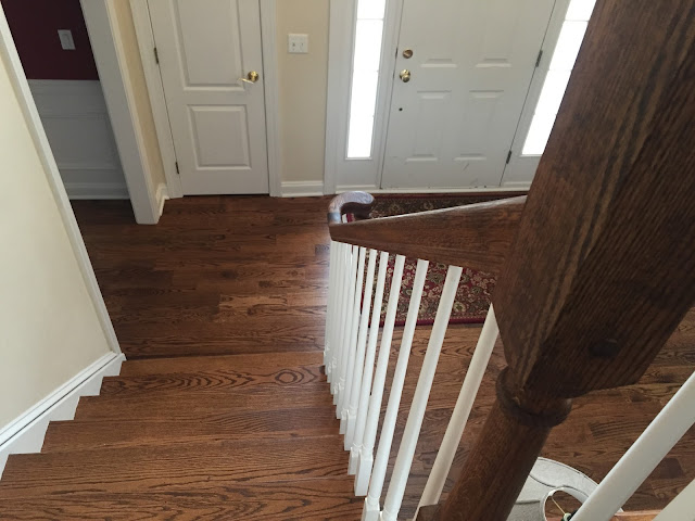 New Staircase with hardwood floors