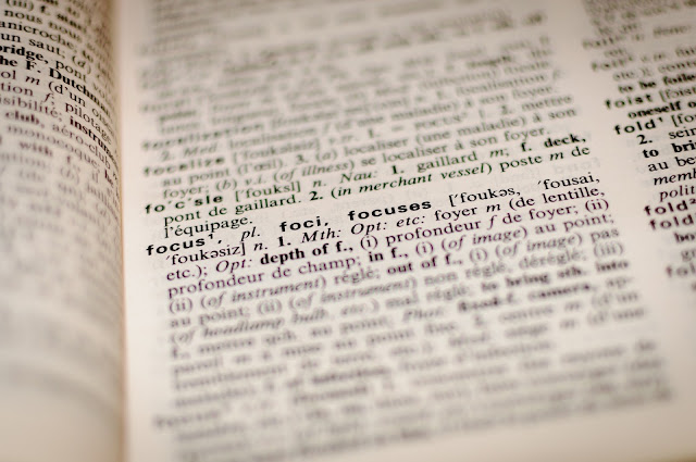 Page of a dictionary with the word focus highlighted