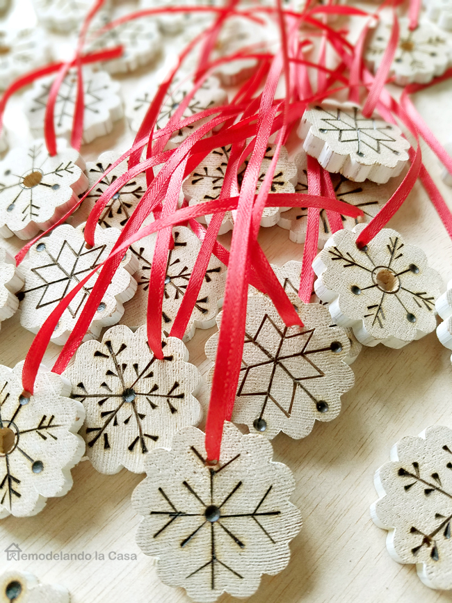 red ribbon on snowflakes, wooden ornaments, snowflake designs